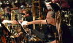 Bass trombonist Bill Reichenbach changes to the next cue