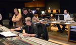 Violinist Bruce Dukov, composer Trevor Morris, and recording mixer Jim Hill look over a cue as score mixer Phil McGowan observers