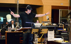 Composer Trevor Morris conducts