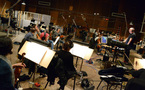 Composer/conductor Trevor Morris and the orchestra wait for the next clip to be cued up