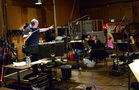 Composer Trevor Morris conducts the orchestra on a cue from his score to <i>Of Kings and Prophets</i>
