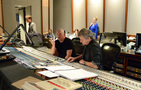 Composer Trevor Morris and recording mixer Jim Hill listen to the mix
