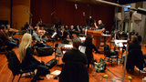 The orchestra records with conductor/composer Trevor Morris