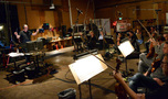Composer Trevor Morris conducts the orchestra