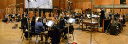 Composer/conductor Trevor Morris and the orchestra prepare to record