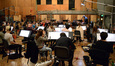 Composer and conductor Chris Lennertz and the orchestra prepare for the next cue