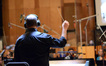 Composer Chris Lennertz conducts the Hollywood Studio Symphony