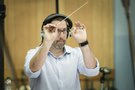 Composer Christopher Lennertz conducting the score to <em>Sausage Party</em>