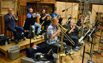 The brass section performs on <i>Sing</i>