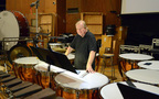 Timpanist Don Williams takes a break from performing