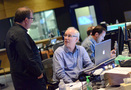 Orchestra contractor Peter Rotter talks with music editor Michael Connell