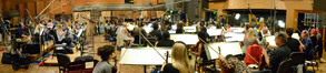 Conductor Mark Graham and the orchestra record a cue from <i>Sing</i>