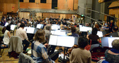 The Hollywood Studio Symphony records a cue with conductor/orchestrator Tim Simonec