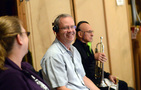 Trumpet players Jon Lewis and Marissa Benedict share a laugh