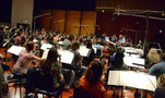 Conductor/orchestrator Nicholas Dodd and the orchestra wait to record