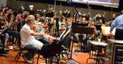 The orchestra rehearses