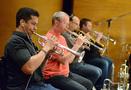 The trumpets perform: Barry Perkins, Jon Lewis, Dan Rosenboom, and Rob Schaer