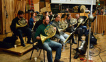 French hornists Ben Jaber, Laura Brenes, Jenny Kim, Dan Kelley, Allen Fogle, Mark Adams, Steve Becknell, and Dave Everson