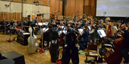 Conductor Jeffrey Schindler and the orchestra