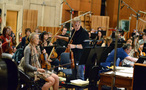 Violinist Bruce Dukov talks to his section