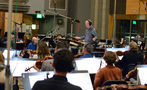 The orchestra performs with conductor Jeffrey Schindler