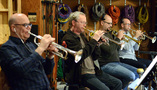 Dan Fornero, Jon Lewis, Dan Rosenboom and Dustin McKinney on trumpets