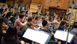 The orchestra records a cue