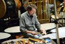 Timpanist Greg Goodall tunes the timpani