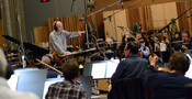 Conductor Jeffrey Schindler goes over a cue with the Hollywood Studio Symphony