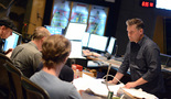 Choir conductor Jasper Randall talks with composer John Ottman
