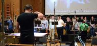 Choir conductor Jasper Randall gives feedback to the choir