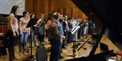 The choir records a cue
