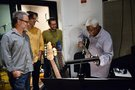Directors Rich Moore and Byron Howard and composer Michael Giacchino watch in awe as legendary bass musician Abe Laboriel Sr. shows them how it's done