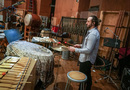 Percussionist Haig Shirinian performs on suspended cymbal