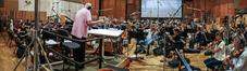 Conductor Tim Simonec and the orchestra record a cue from Michael Giacchino's score for <i>War for the Planet of the Apes</i>