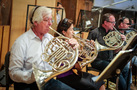 The French horns perform