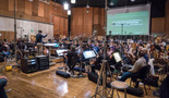 Conductor Marshall Bowen and the orchestra record music for the <i>War for the Planet of the Apes</i> theatrical trailer