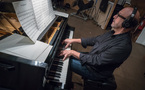 Composer Randy Kerber plays the piano