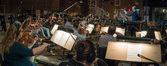 The strings records a cue for <i>The Dark Tower</i> with conductor Ed Trybeck