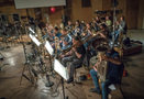 The brass section performs on <em>The Dark Tower</em>