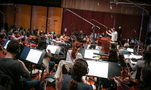 Conductor Nick Glennie-Smith and the orchestra record a cue for <em>Despicable Me 3</em>