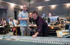 Composer Rolfe Kent and scoring mixer Greg Townley adjust the mix