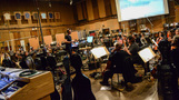 Composer/conductor Brian Tyler talks with the cello section