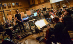 Composer Brian Tyler conducts the cello section