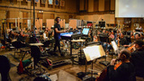 Composer/conductor Brian Tyler takes a quick glance at the camera