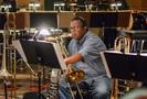 A trombonist prepares for the next cue