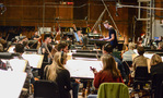 Composer/conductor Brian Tyler with the orchestra