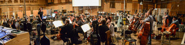 Composer Brian Tyler and the orchestra during the sessions for <i>The Fate of the Furious</i>
