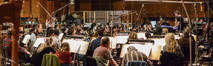 Composer/conductor Brian Tyler and the Hollywood Studio Symphony record a cue