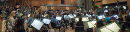 Composer John Powell chats with the orchestra